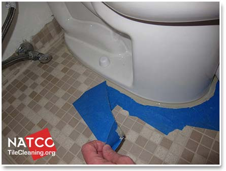 removing caulking tape from around toilet