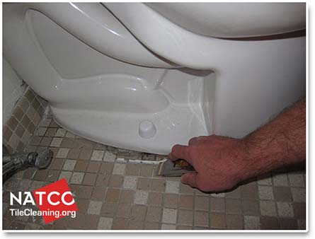 removing old toilet caulk with razor blade