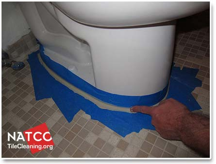 smoothing caulk around toilet