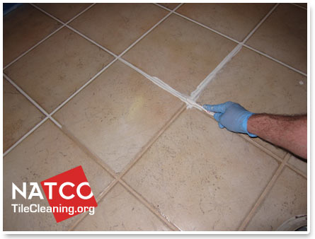Cleaning latex paint from grout