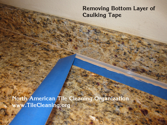 applying caulk to granite countertop