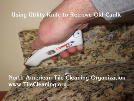 removing granite countertop caulk with utility knife