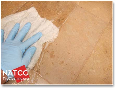 applying sealer to travertine floor tiles