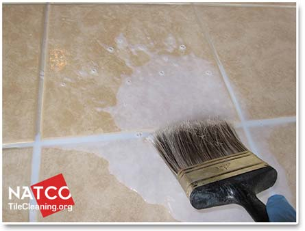 applying a topical sealer to ceramic tiles