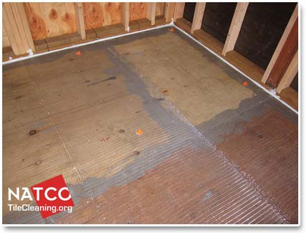How to level a floor with a self leveling compound for Floor leveling compound for wood subfloors