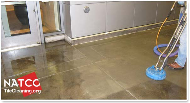 Steam cleaning concrete to remove dirt grease and stains for Cleaning stained concrete floors steam mop